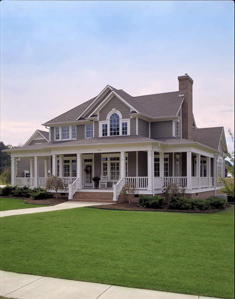 Custom two story country home plan maverick for Country style homes with wrap around porch